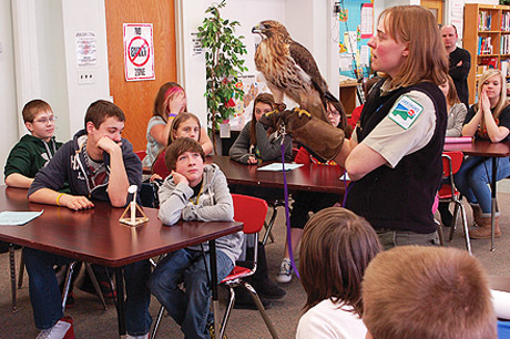 Interpreters lead a wildlife education and outreach program at a local area school